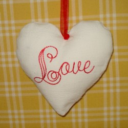 love lettering padded heart hanging ornament made in the machine embroidery hoop lavender filled linen heart needle passion embroidery npe